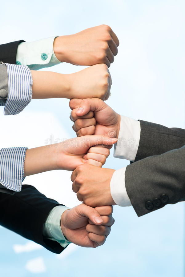 We are stronger together. Business team stacking fists together for cooperation stock image