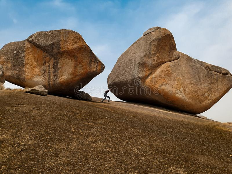 Strongest man. Rocks, sky, mountain stock photography