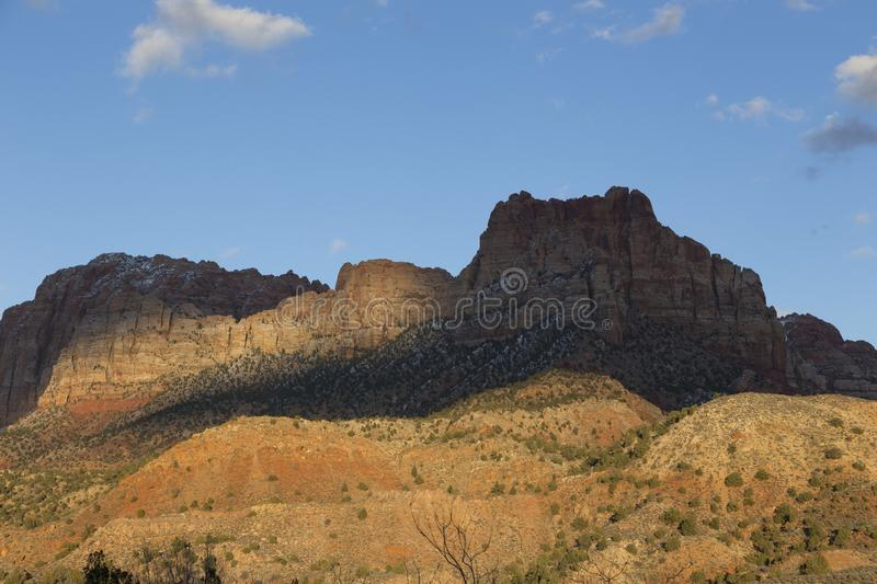 Strongly contrasted and colourful mountain panorama in Springdale, near Zion National Park. Utah, USA, at sunset stock photo