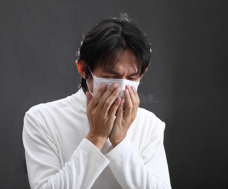 Strongly coughing young man suffered from asthma.  royalty free stock image
