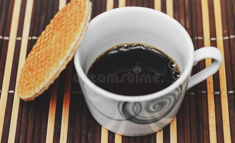 Stroopwafel and black coffee stock photography