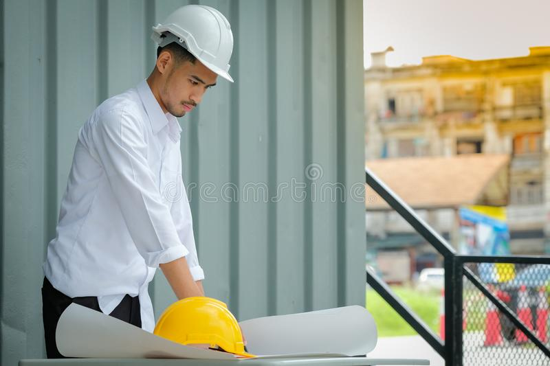 Structural engineers are going to drafted on white paper. royalty free stock image