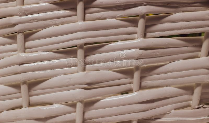 The structure and background of the wicker basket. Pattern round texture. Vertical and horizontal weave royalty free stock photo