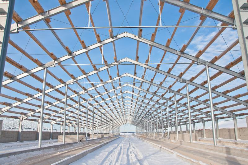 Steel construction on the background of the winter landscape. stock photo