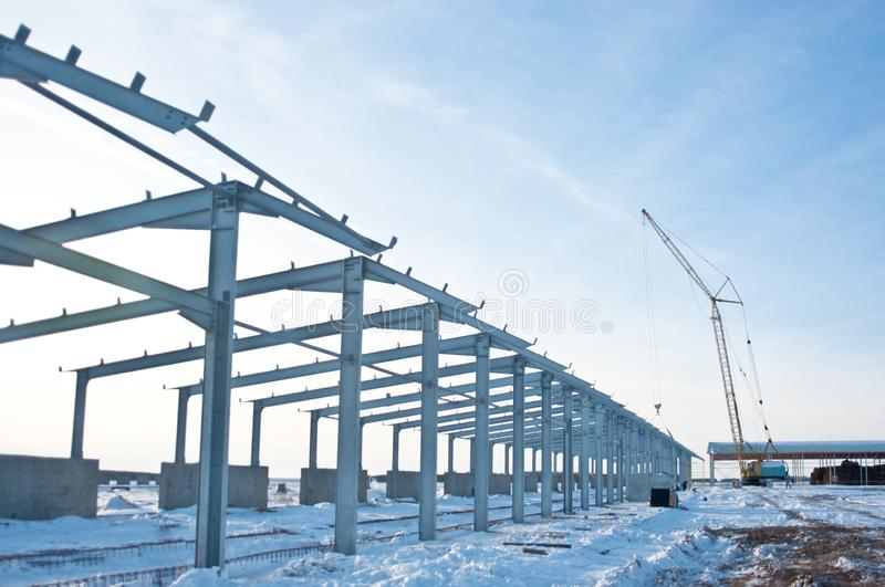 Steel construction on the background of the winter landscape. royalty free stock photo