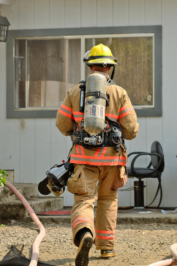 Structure Fire. Roseburg, Oregon - July 31, 2013: Fire fighters respond to a structure fire in a residence that caused major interior damage. No body was injured stock photos