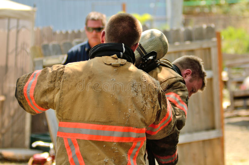 Structure Fire. Roseburg, Oregon - July 31, 2013: Fire fighters respond to a structure fire in a residence that caused major interior damage. No body was injured royalty free stock photos