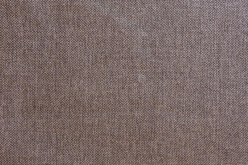 Structure of gray cloth with natural texture. Cloth backdrop. The texture of gray fabric textile upholstery of furniture royalty free stock images