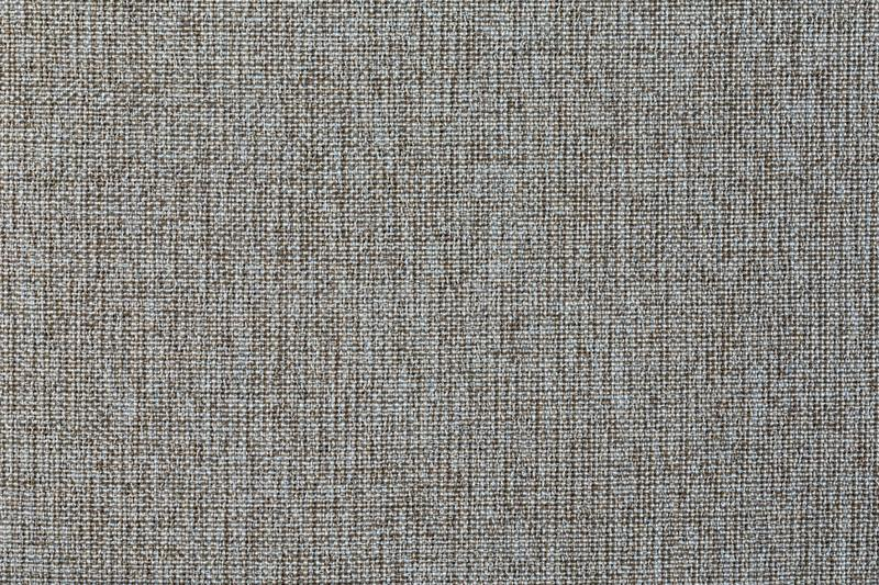 Structure of gray cloth with natural texture. Cloth backdrop. The texture of gray fabric textile upholstery of furniture. Structure of the ginger cloth with stock images