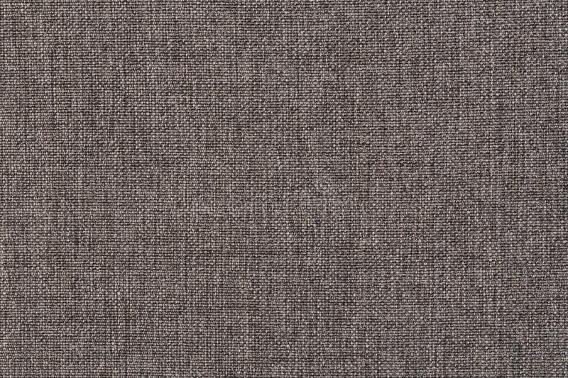 Structure of gray cloth with natural texture. Cloth backdrop. The texture of gray fabric textile upholstery of furniture. Structure of the ginger cloth with royalty free stock photography