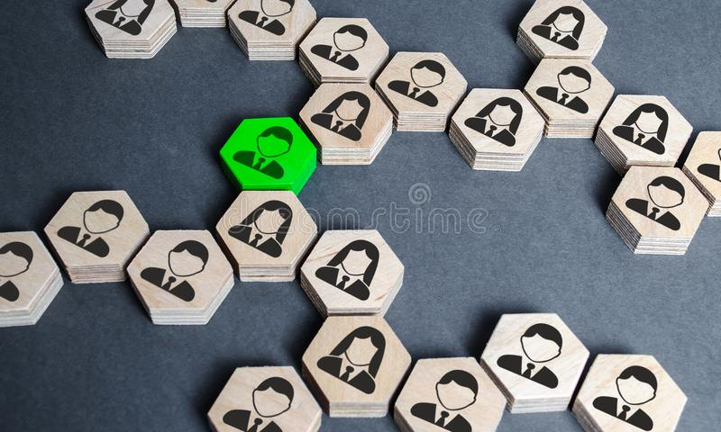 The structure of hexagonal figures with employees is connected together through a green figure. Establishing contact stock images