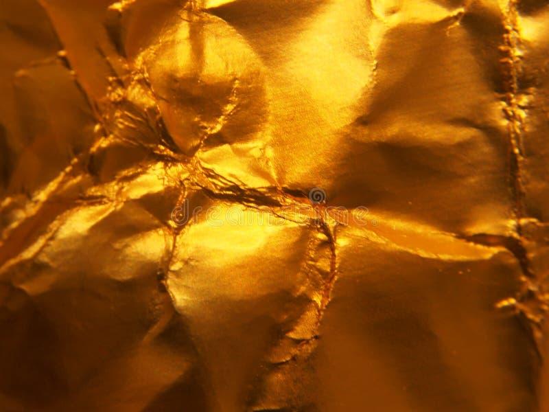 Structure métallique d'or La texture du clinquant image libre de droits