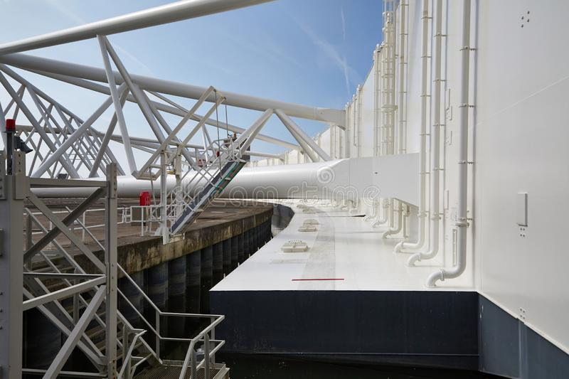 Structure of a movable flood barrier gate. Huge steel structures of the storm surge barrier maeslantkering near Rotterdam, protecting the Netherlands against stock photo