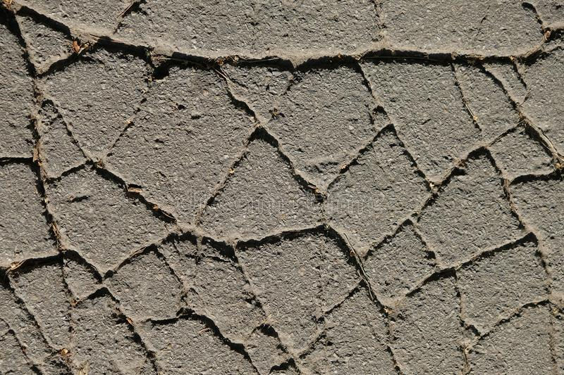 Structure of old cracked asphalt with deep cracks. Abstract grunge texture background. stock photos