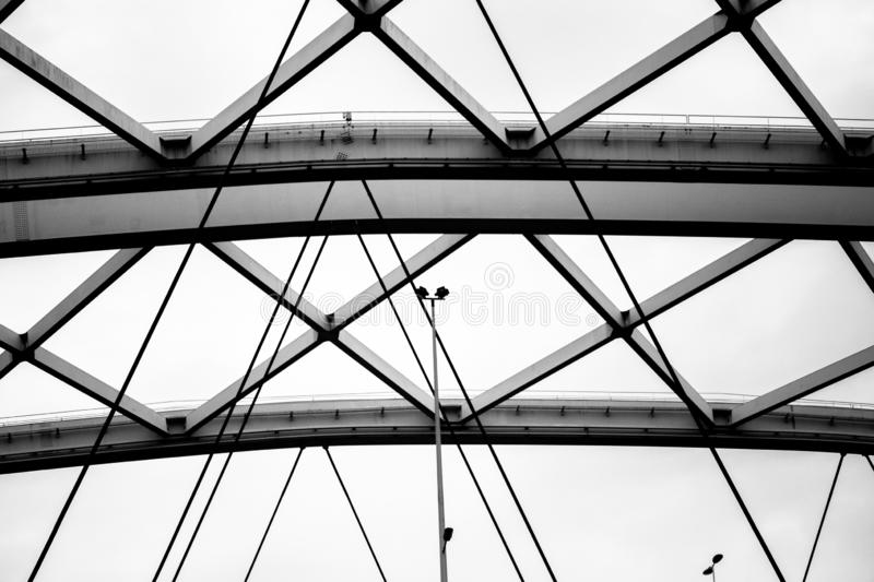 Structure of steel beams and cables in black and white stock photo
