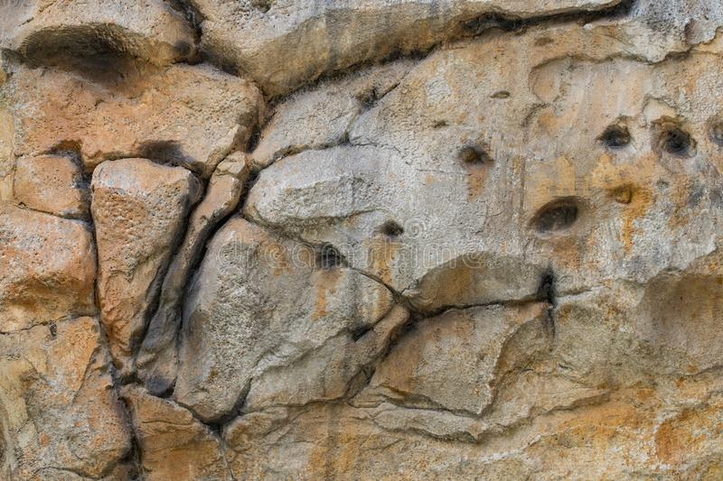 Structure of surface of the stone, used as background. Stone texture. Natural rocks stock images
