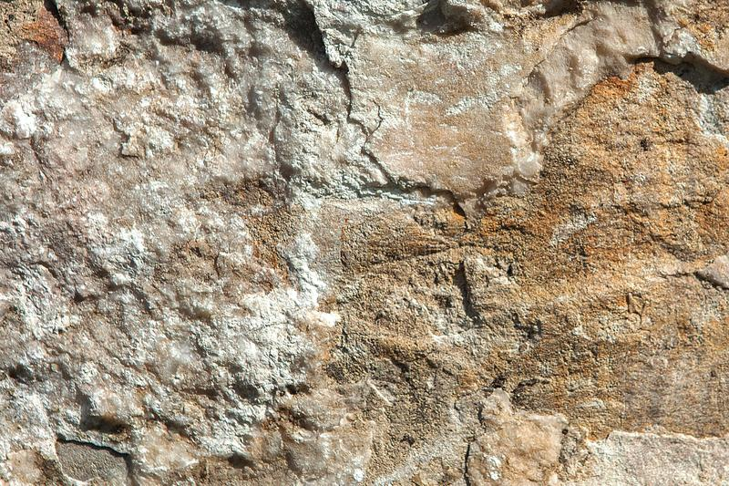 Structure of surface of the stone, used as background. Stone texture. Natural rocks royalty free stock images