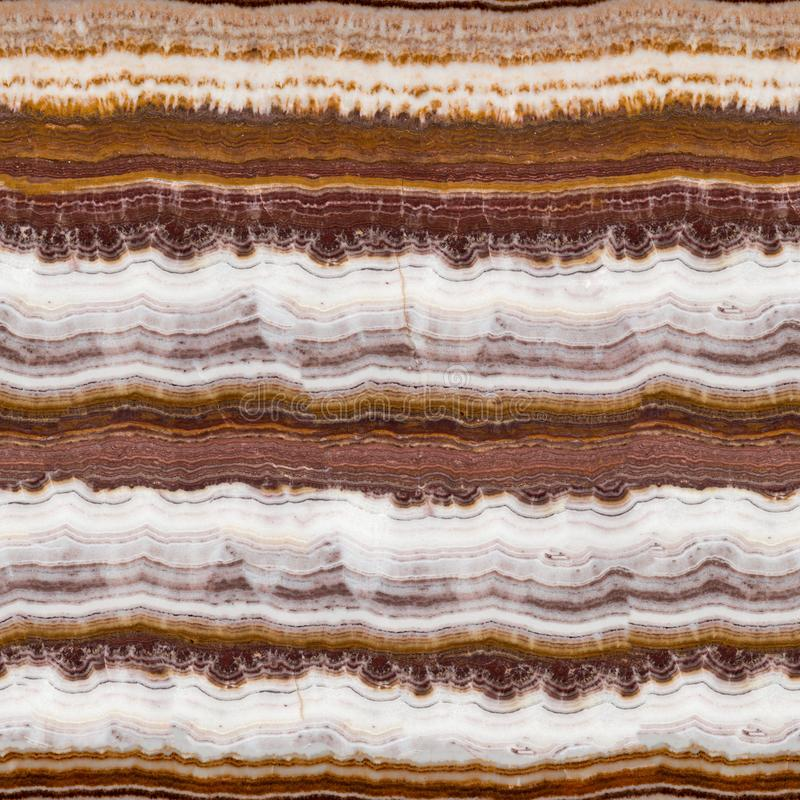 The structure of the variegated onyx with a natural crack. Seamless square background, tile ready. High resolution photo royalty free stock image