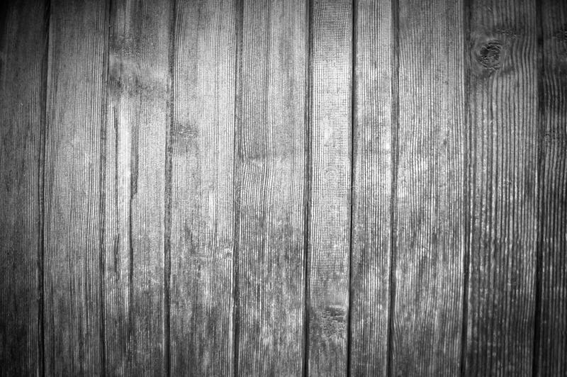 Black and white background with beautiful structure of vertical wooden boards stock photography