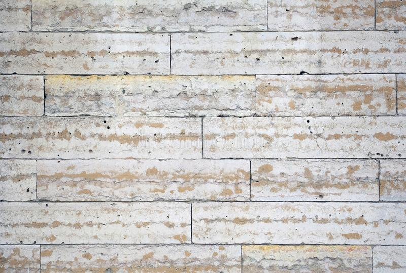The structure of the wall of stone blocks under marble royalty free stock image