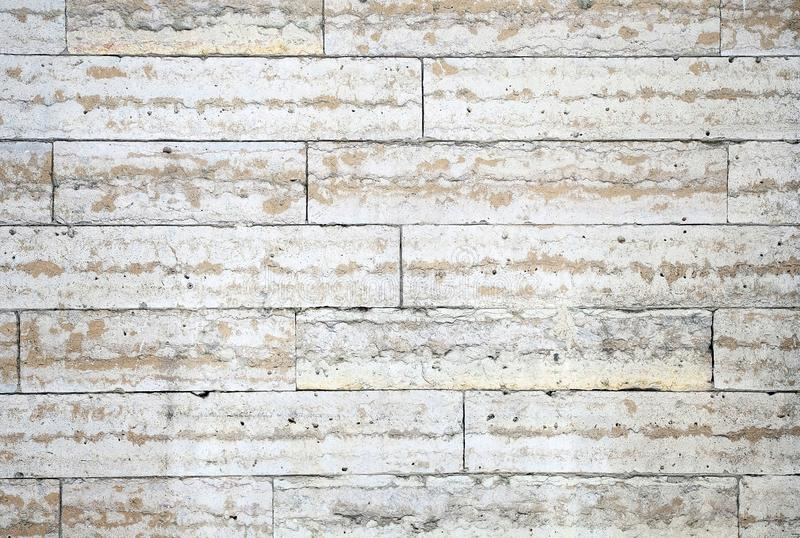 The structure of the wall of stone blocks under marble royalty free stock photography