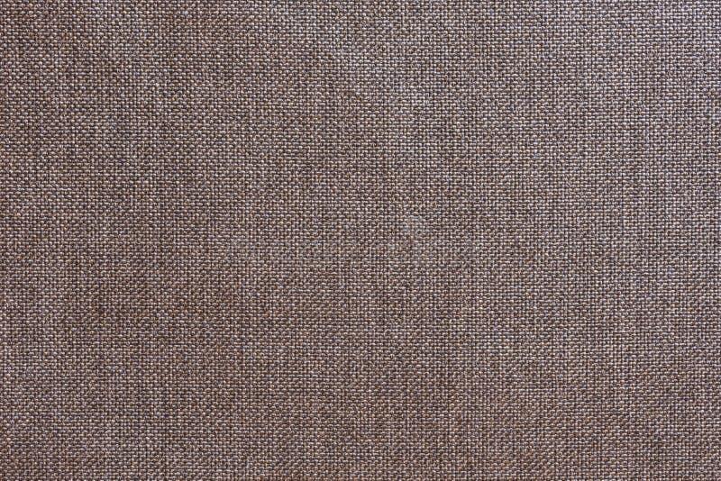 Structuur van grijze doek met natuurlijke textuur Doekachtergrond De textuur van grijze stoffen textielstoffering van meubilair royalty-vrije stock afbeeldingen