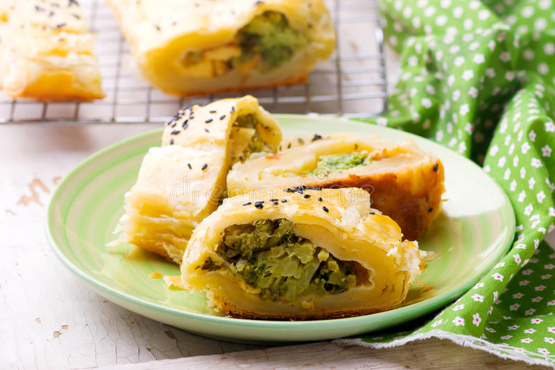 Strudel with broccoli and scamorza .selective focus. Style rustic royalty free stock images