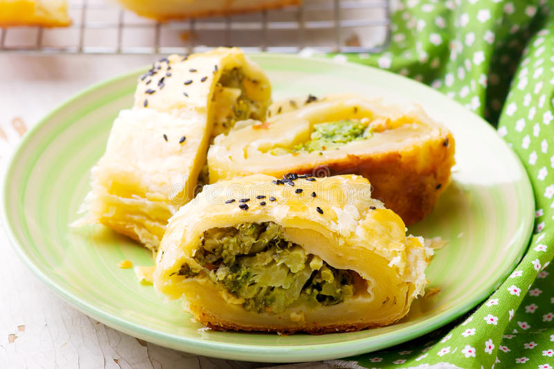 Strudel with broccoli and scamorza .selective focus. Style rustic stock photo