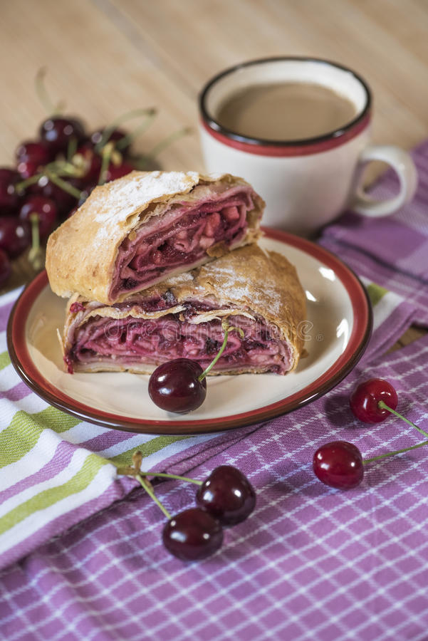Strudel, coffee, cherries stock photography