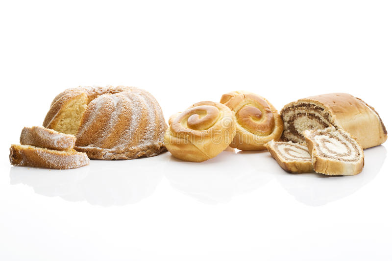 Strudel filled with nuts buns filled with cream ring cake on white background stock photo