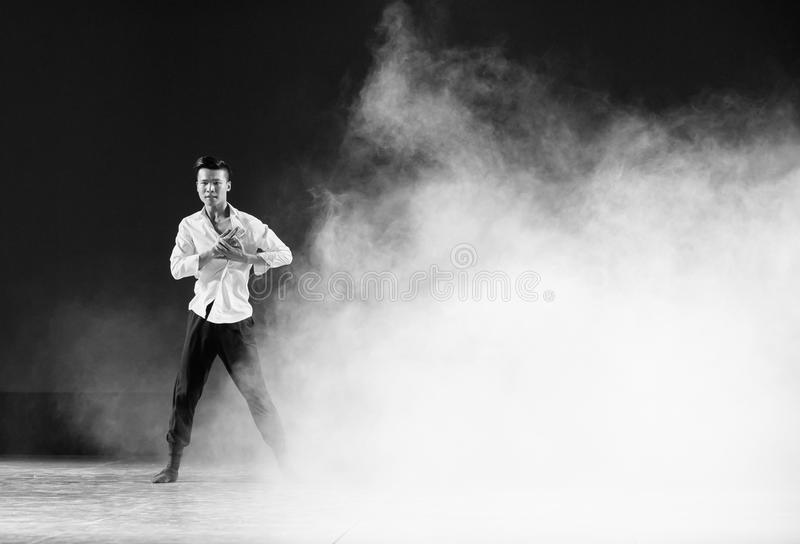 Struggle in the fog and haze-Modern dance. Graduation performance of class5, grade 11, dancing department,Jiangxi Vocational Academy of Art on Dec30,2015 royalty free stock image