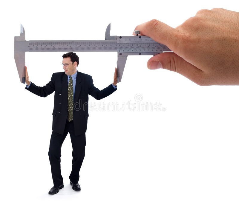 Struggling businessman. Businessman struggling to push apart a caliper to fit the required dimension stock images