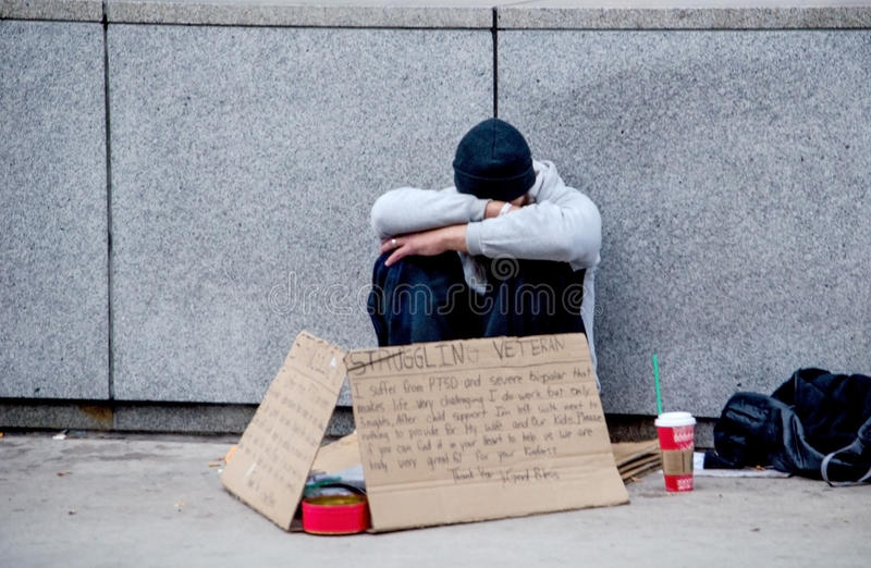 Struggling veteran. A struggling veteran begs for help on the streets of chicago USA. Despair often brings people down on their luck, or dealing with health and/ stock photography
