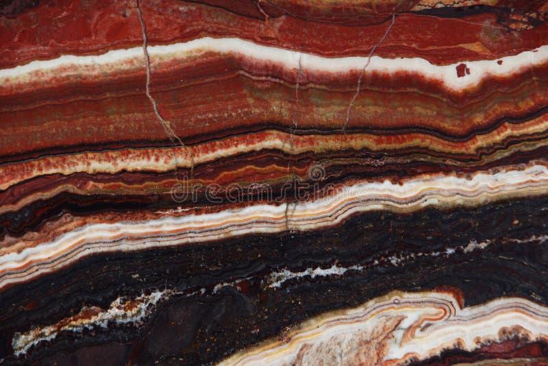 Struktura onyks, jaskrawy czerwony kolor z cienkimi żyłami, dzwoni Onice Fantastico obraz stock