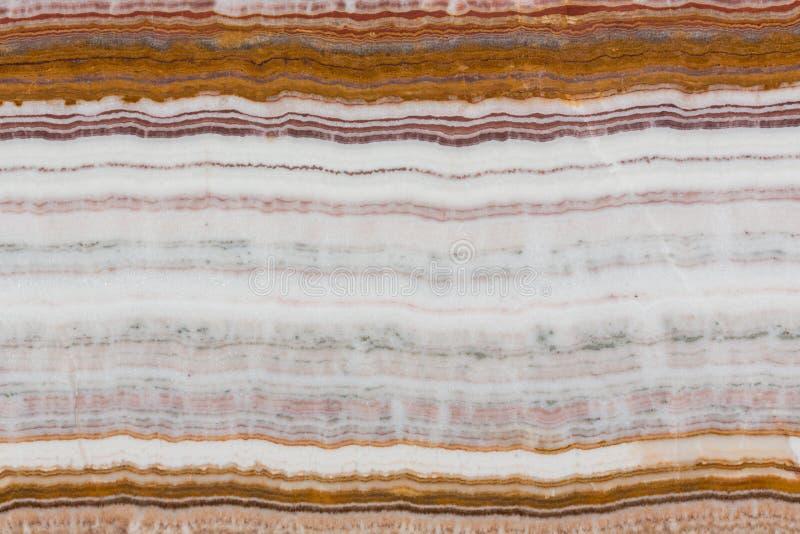 Struktura wielo- barwiony onyksu kamień zamknięty w górę obrazy stock