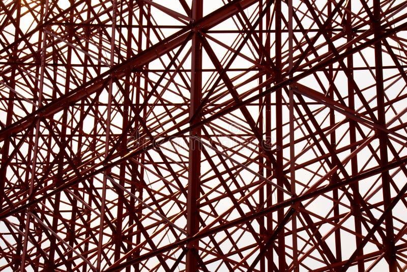 Struktureller orange Stahlquerbauzusammenfassungshintergrund stockbild
