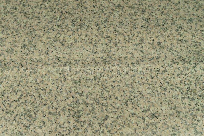 Strukturen av gr? f?rg-beiga granit en naturlig sten Industriell granitworktop i restaurangen royaltyfri fotografi