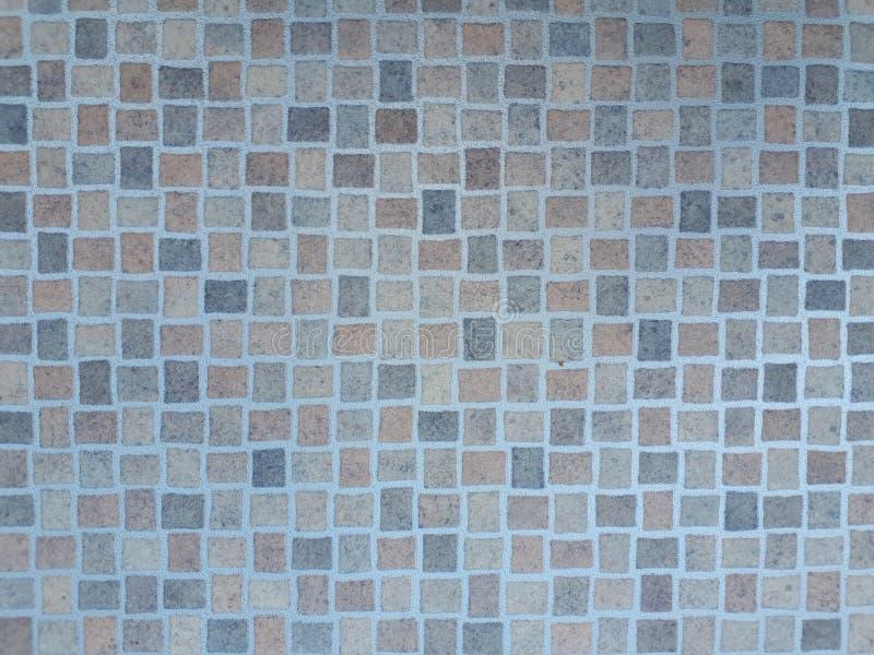 Strukturierte Hintergrundwand oder -boden des Keramikziegels stockbild