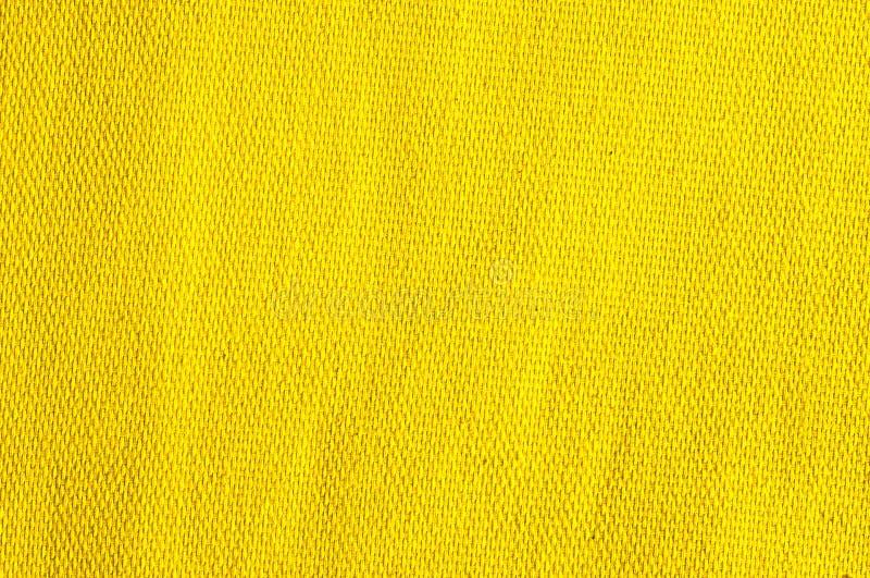 Strukturierter Hintergrund des gelben Gewebes lizenzfreies stockfoto