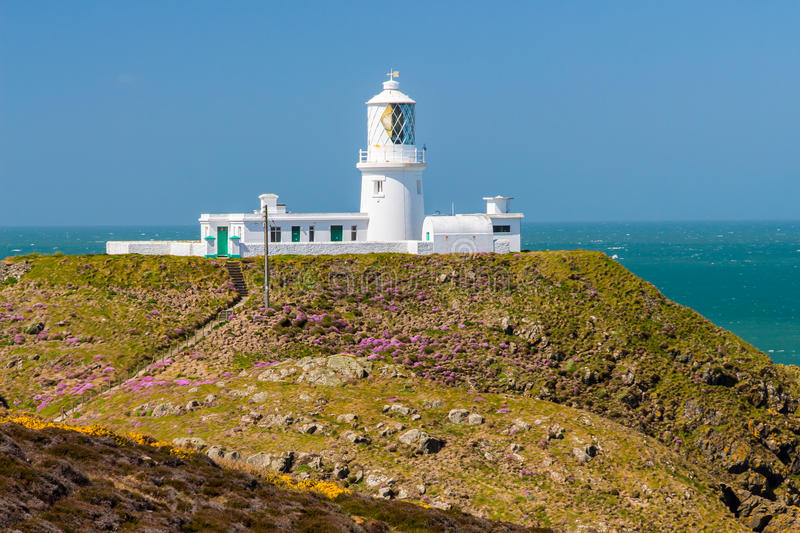 Strumble Head Lighthouse Wales. Strumble Head and the 1908 Lighthouse on the Pembrokeshire coast of Wales UK Europe royalty free stock photos