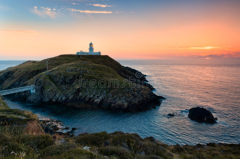 Strumble Head Lighthouse, Wales. White lighthouse on a rocky islet in the northern coast of Pembrokeshire, Wales royalty free stock photography