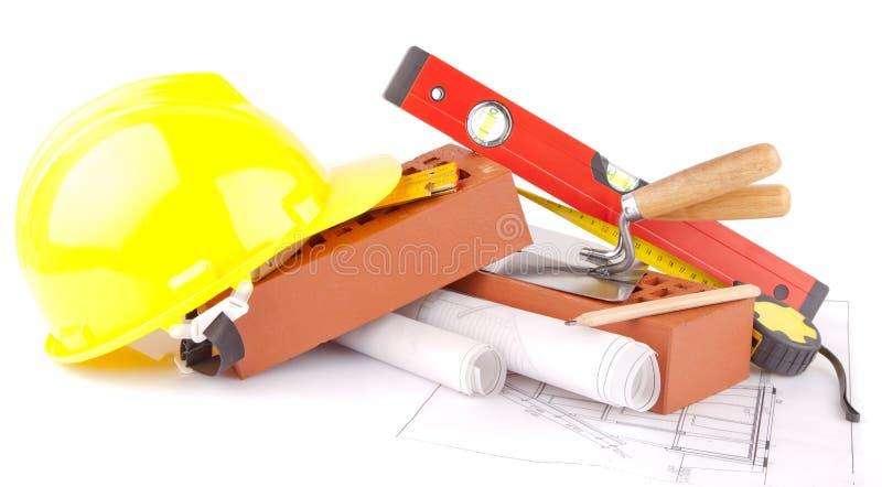 Strumenti della costruzione del muratore e dei mattoni immagine stock libera da diritti
