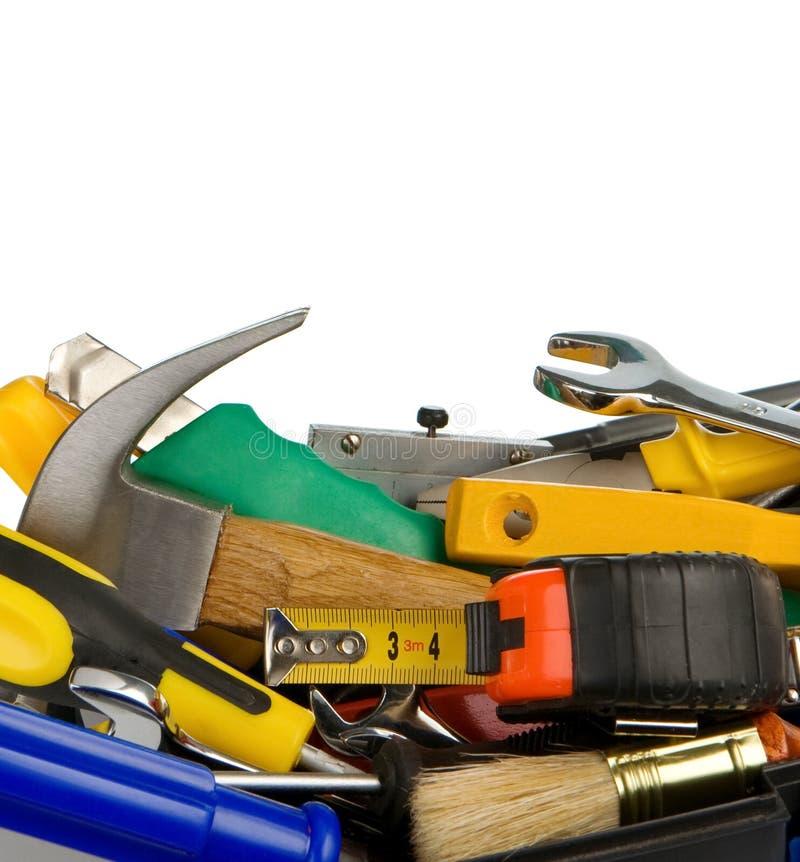 Strumenti e strumenti in casella isolata su wh fotografia stock libera da diritti
