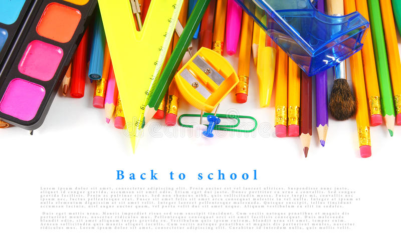 Strumenti ed accessori della scuola su fondo bianco fotografia stock