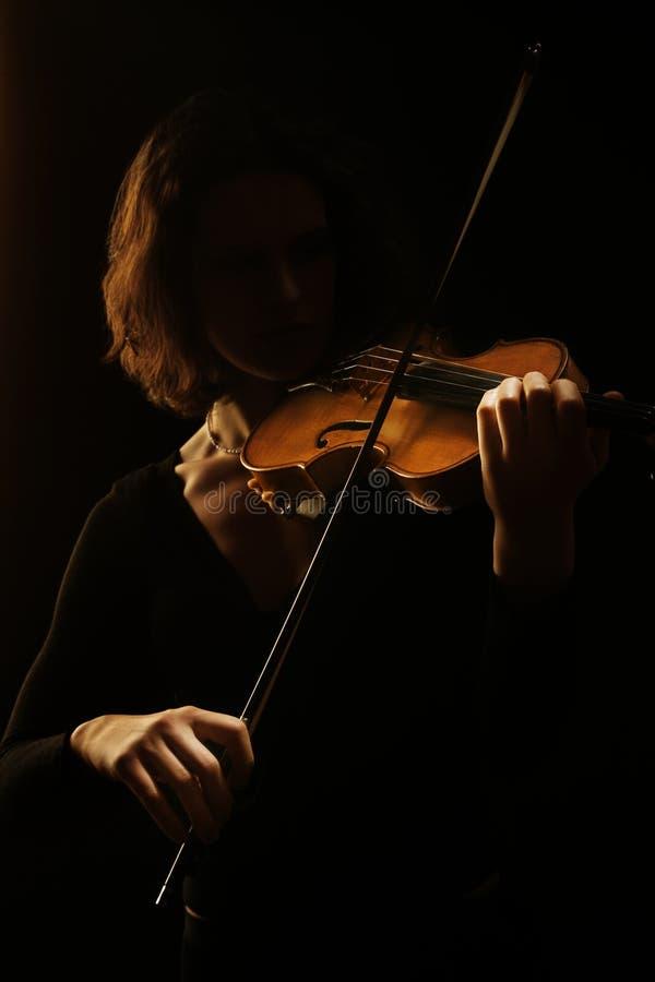Strumenti musicali che giocano concerto del violino fotografia stock