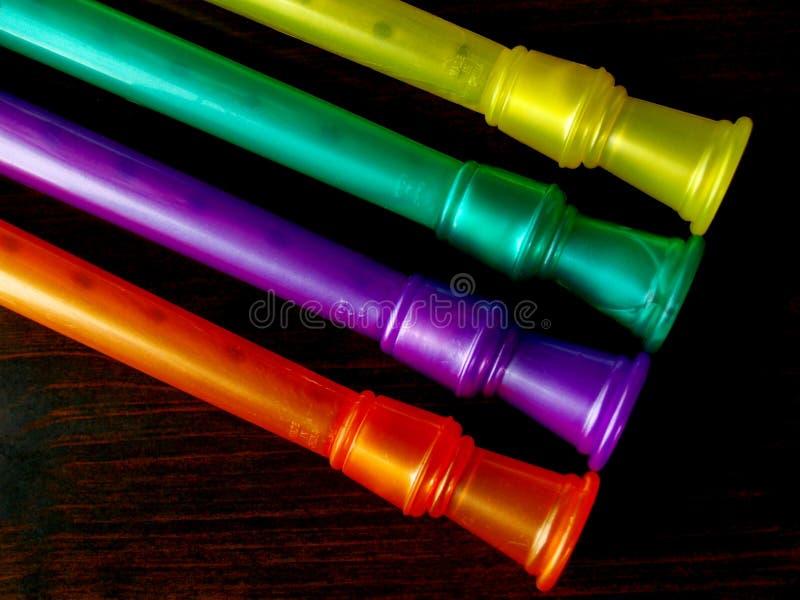 Strumenti musicali di plastica variopinti fotografia stock