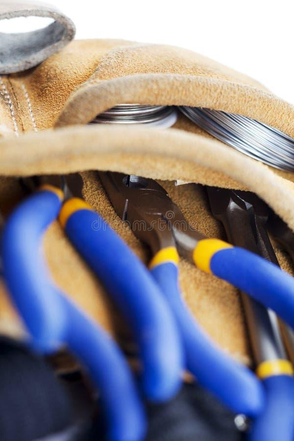 Strumenti su una cinghia dei carpentieri fotografia stock libera da diritti
