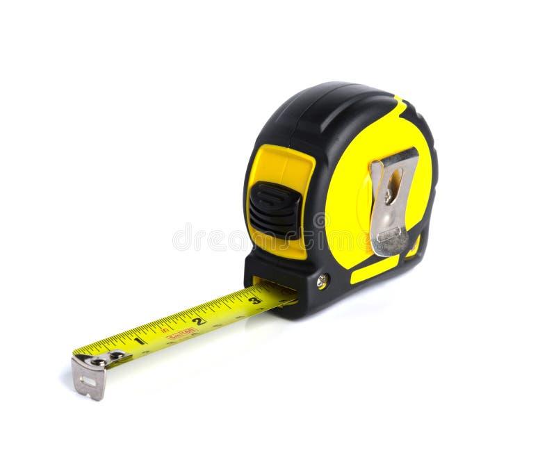 Strumento giallo della costruzione di misura su fondo bianco fotografia stock