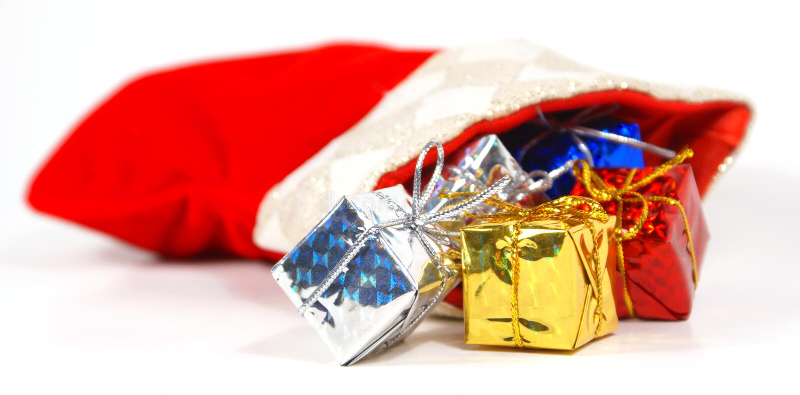 Strumpf mit Geschenken lizenzfreies stockfoto