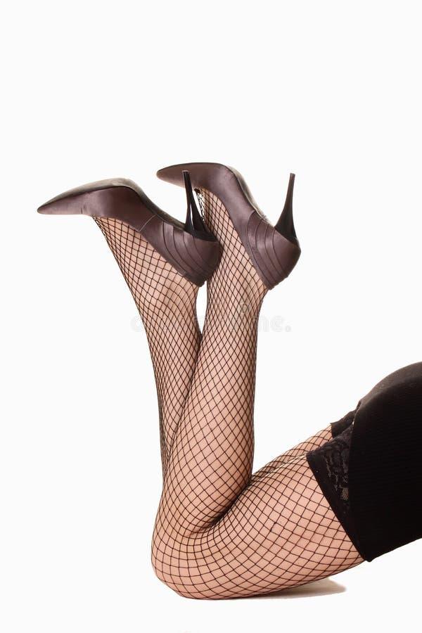 strumpor för ben s för härliga foliehäl höga royaltyfri bild